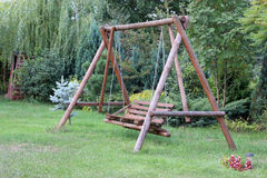 Teeter. Wooden teeter in a garden Royalty Free Stock Photography