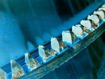 Teeth. Color-inverted closeup of a cogwheel (cement mixer Stock Image