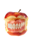 Teeth and apple Stock Images