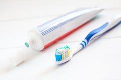 Teeth brush and paste tube dental hygiene Royalty Free Stock Image