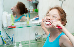 Teeth brushing Stock Images