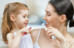 Teeth brushing. Mother and daughter brush my teeth Royalty Free Stock Photo