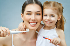 Teeth brushing. Mother and daughter brush my teeth Royalty Free Stock Image