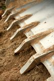 Teeth on a bulldozer scoop. Close-up of the teeth on a bulldozer scoop. Shallow depth of field royalty free stock photography