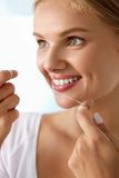 Teeth Care. Beautiful Smiling Woman Flossing Healthy White Teeth Royalty Free Stock Image