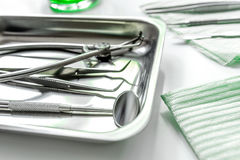 Teeth care with dentist instruments in doctor`s office white background Royalty Free Stock Images
