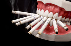 Teeth and Cigarettes Stock Images
