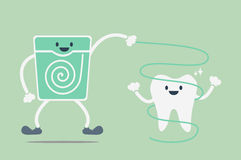 Teeth cleaning by dental floss Stock Photo