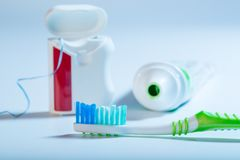 Teeth cleaning set on blue background stock image