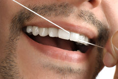 Teeth. Dental floss. Stock Images