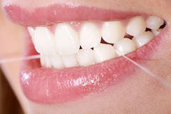 Teeth with dental floss. Mouth and teeth with dental floss Royalty Free Stock Photography