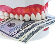Teeth and dollar Royalty Free Stock Photos