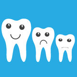 Teeth with emotions on a blue Stock Photo