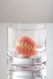 Teeth on glass Royalty Free Stock Photo