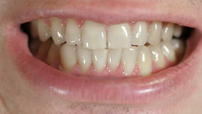 Teeth of a man. A man opening mouth and showing the white teeth stock footage