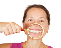 Teeth of mature woman through magnifier Stock Image