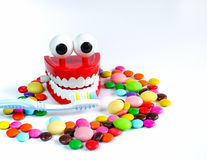Teeth mock up with toothbrush and colorful candies. Dental care concept Stock Photography