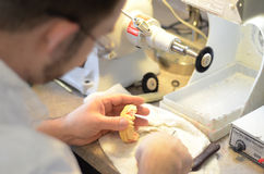 Teeth mold. A worker making teeth in a lab Royalty Free Stock Photo