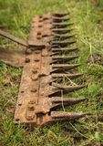 Crop Cutter Bar. Teeth on a old rusted crop cutter bars royalty free stock photography