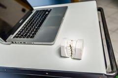 Teeth plaster cast near laptop Royalty Free Stock Photos