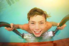 Teeth smiling teenager boy in swimming pool Stock Photo