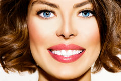 Teeth Whitening. Beautiful Smiling Young Woman Portrait closeup Royalty Free Stock Photography