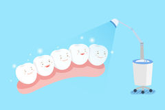 Teeth with whitening concept. Cute cartoon tooth with whiten concept on the blue background Royalty Free Stock Images