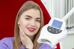 Teeth whitening girl smiling with whitened white teeth stock photo