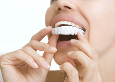 Teeth Whitening - smiling girl with tooth tray Royalty Free Stock Photo