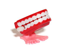 Teeth Wind Up Toy. A teeth wind up toy over white stock photography