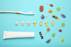 Free Teeth With Sweet Candies. Tooth Caries In Children`s, Dental Healthcare, Toothpaste And Toothbrush Royalty Free Stock Image - 158403386