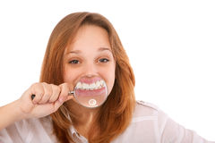 Teeth of young woman through magnifier Stock Photo