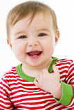 Teething Baby. Teeths are growing with a positive smile. Gatting Ready to sleep in pajamas Stock Image