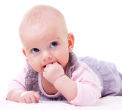 Teething baby Stock Images