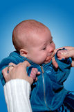 Teething Baby. A 5 month old baby gnawing on her mother's finger while teething Stock Photography