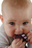 Teething baby boy with a toy. Portrait of six months old sweet baby Royalty Free Stock Photography