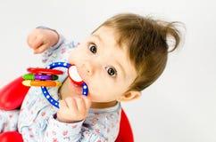 Teething baby girl Stock Image