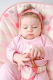 Teething baby girl Stock Photos