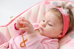 Teething baby girl royalty free stock photos
