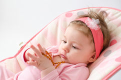 Teething baby girl Stock Images