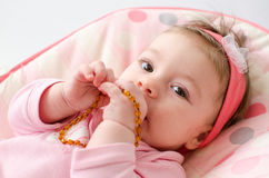 Teething baby girl Royalty Free Stock Photography