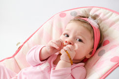 Teething baby girl Stock Image