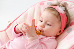 Teething baby girl Royalty Free Stock Image
