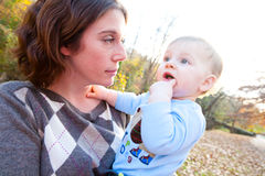 Teething Baby with Mom Royalty Free Stock Images