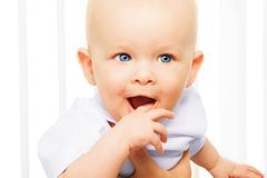 Teething. Little baby with Teething, itching gingiva with a finger Royalty Free Stock Photos