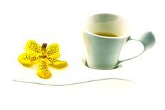 Teezeit, gelbe Orchidee Lizenzfreies Stockfoto