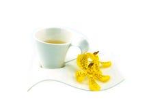 Teezeit, gelbe Orchidee Lizenzfreie Stockfotos