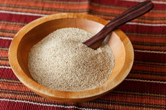 Teff cereal. In a wooden bowl with a spoon stock photos