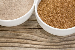 Teff grain and flour. In small ceramic bowls against grained wood background Stock Photo