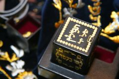 The Tefillin. Special boxes containing the sacred text torah which fasten on a head during a pray Royalty Free Stock Photography